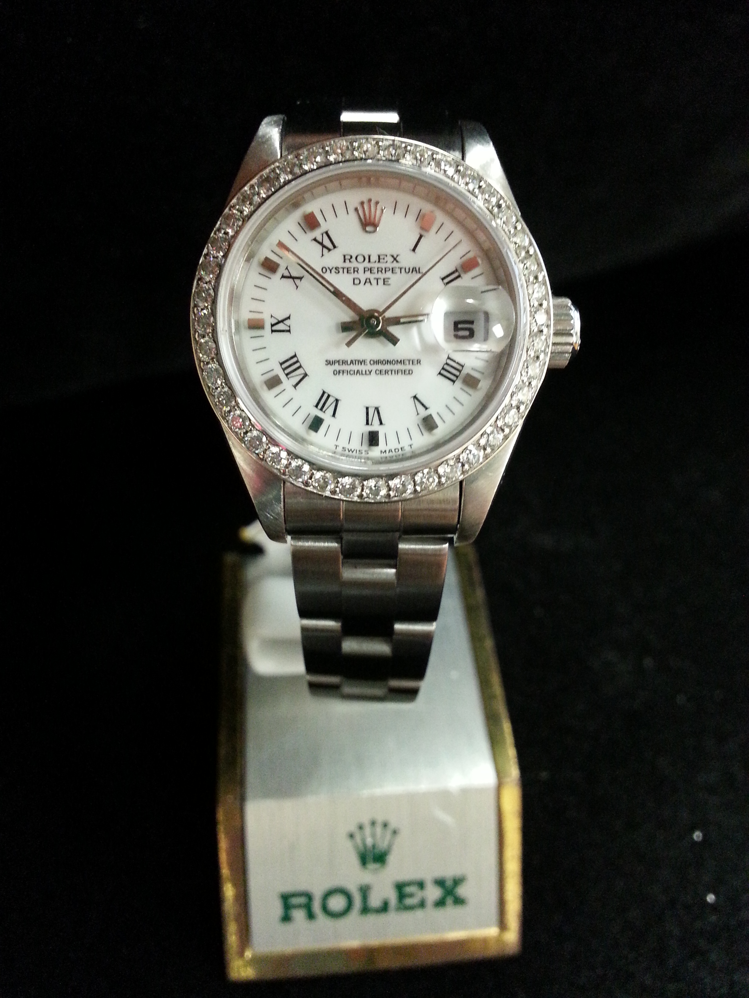 Estate Lady's Rolex: Estate Lady's Stainless Steel Rolex Datejust with Custom Diamond Bezel on Oyster Bracelet.