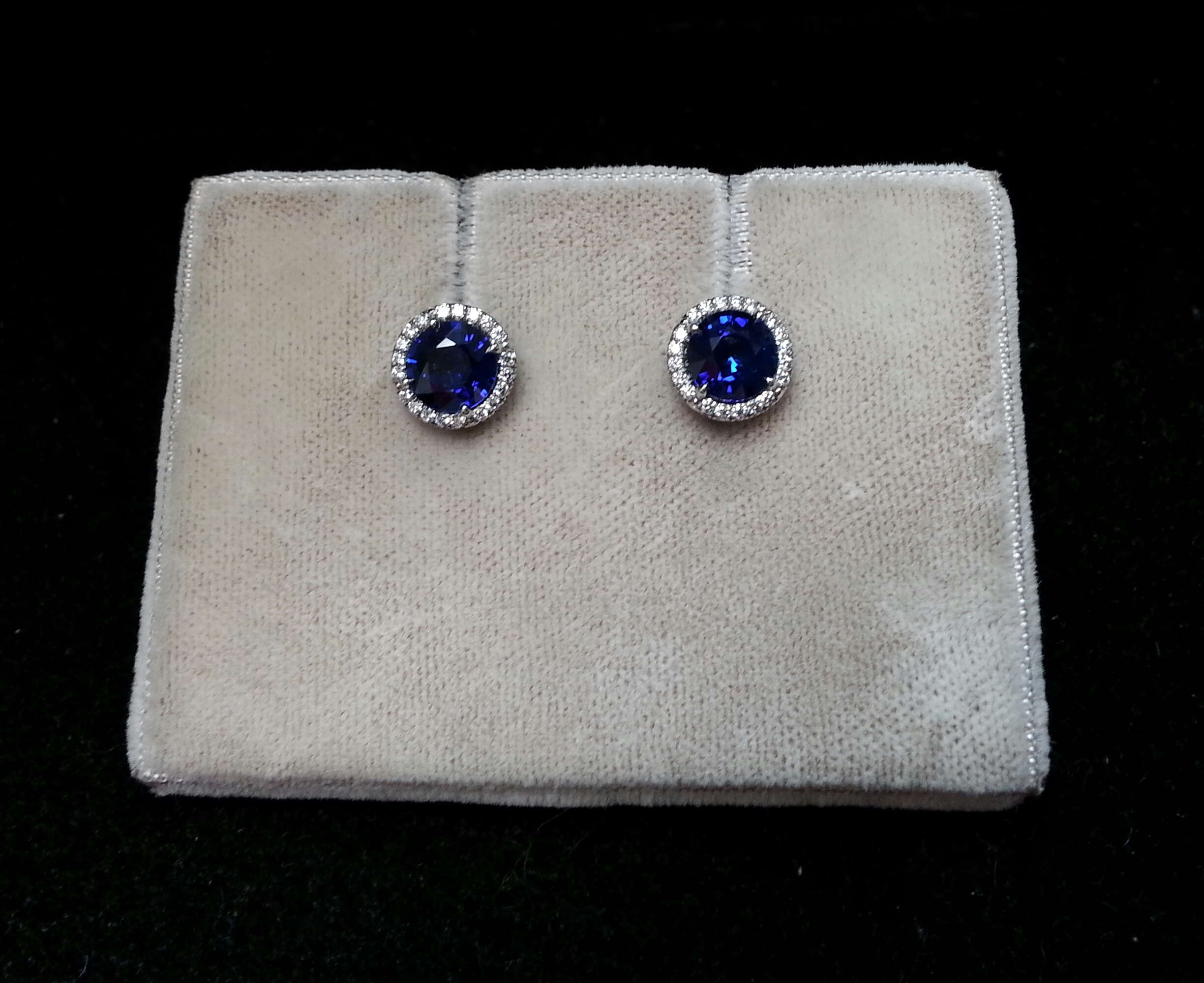 Blue Sapphire Earrings Set in Platinum with Small Diamond Halos Around Sapphires. Sapphires are 1.94ctw and Diamonds are 0.15ctw