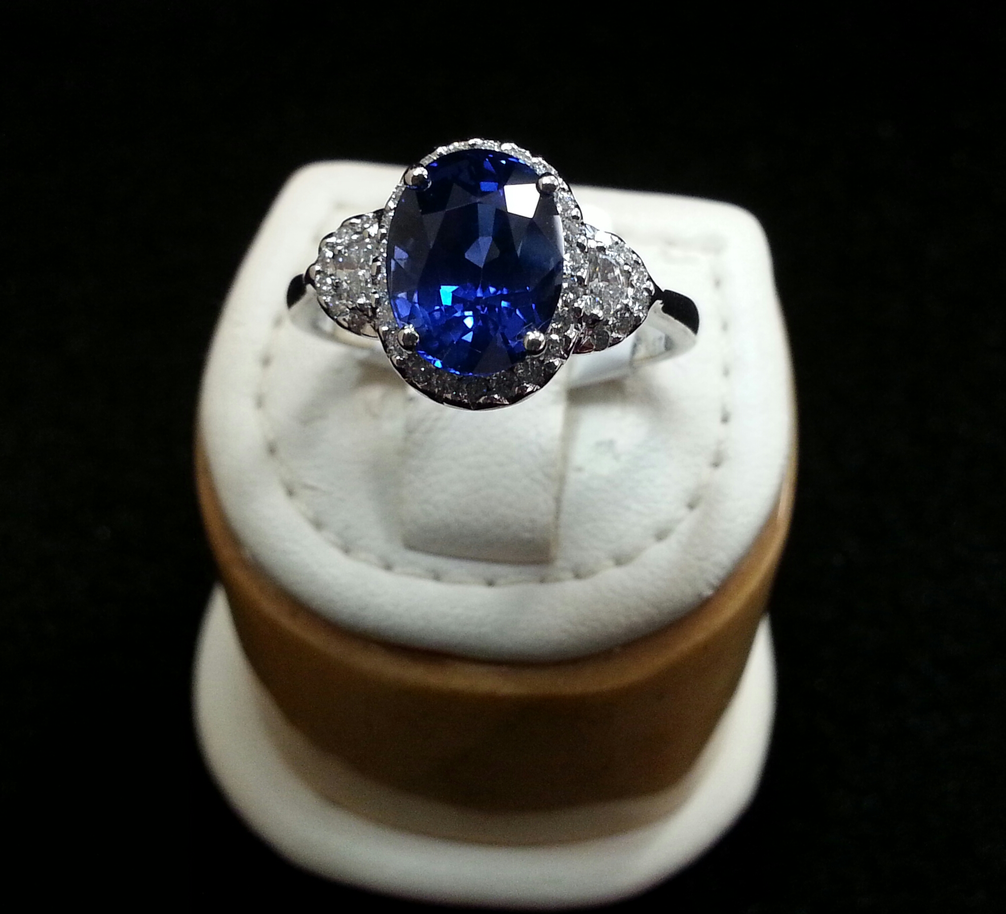 Oval Blue Sapphire and Half Moon Diamond Ring with Micro Pave Set in 18k White Gold. Sapphire is 3.67ct and Diamonds are 0.39ctw