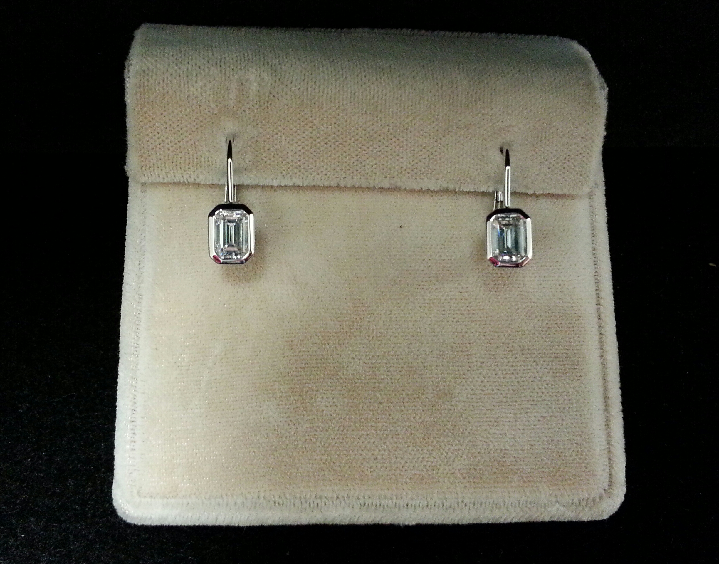 18k White Gold Bezel Set Emerald Cut Diamond Earrings. F/VS-SI D1.15ctw.