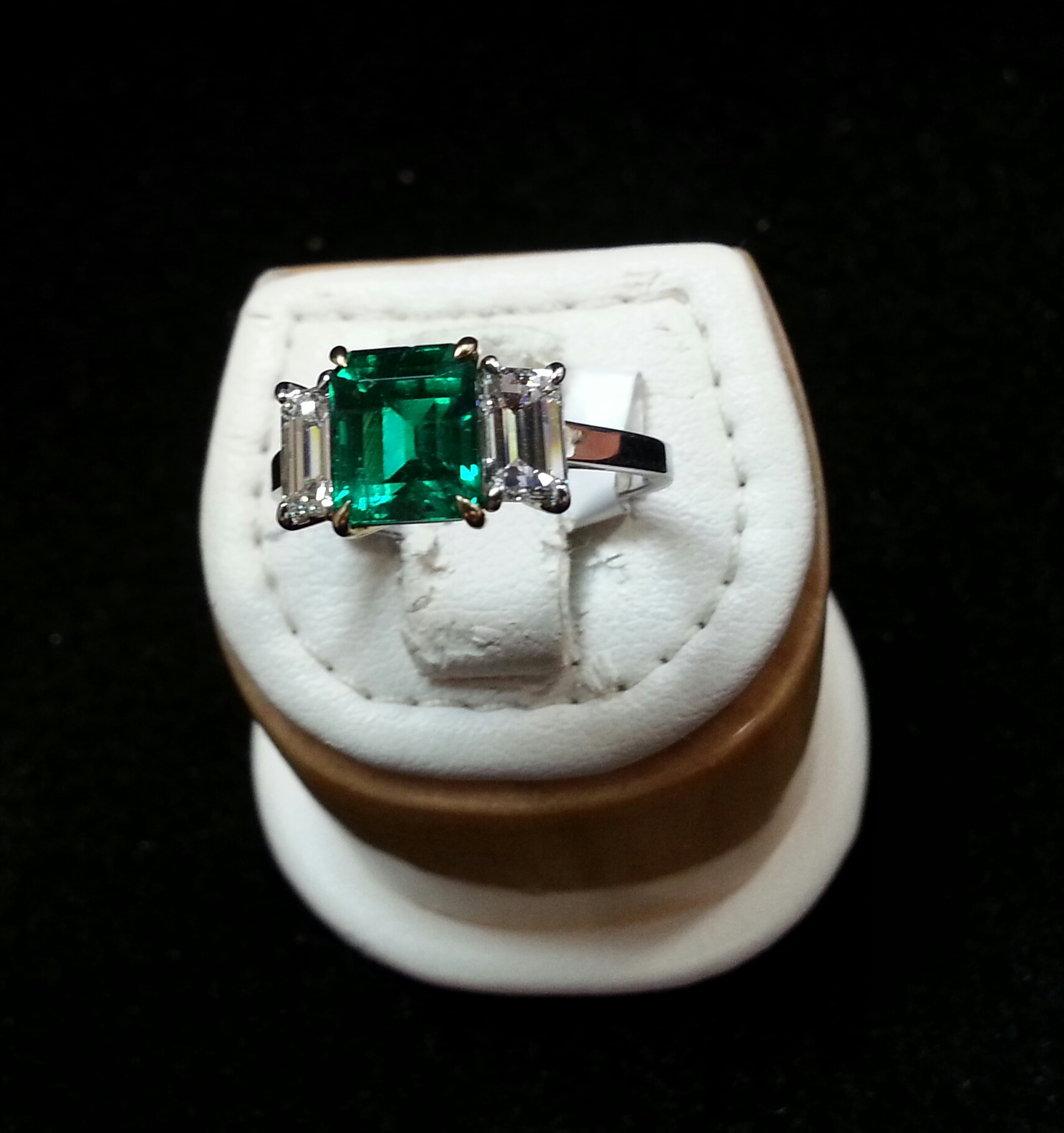Platinum & 18k Yellow Gold Handmade Ring With an Emerald Cut Emerald & Emerald Cut Diamonds. Emerald is 1.64ct and Diamonds are 1.05ctw F/VS1