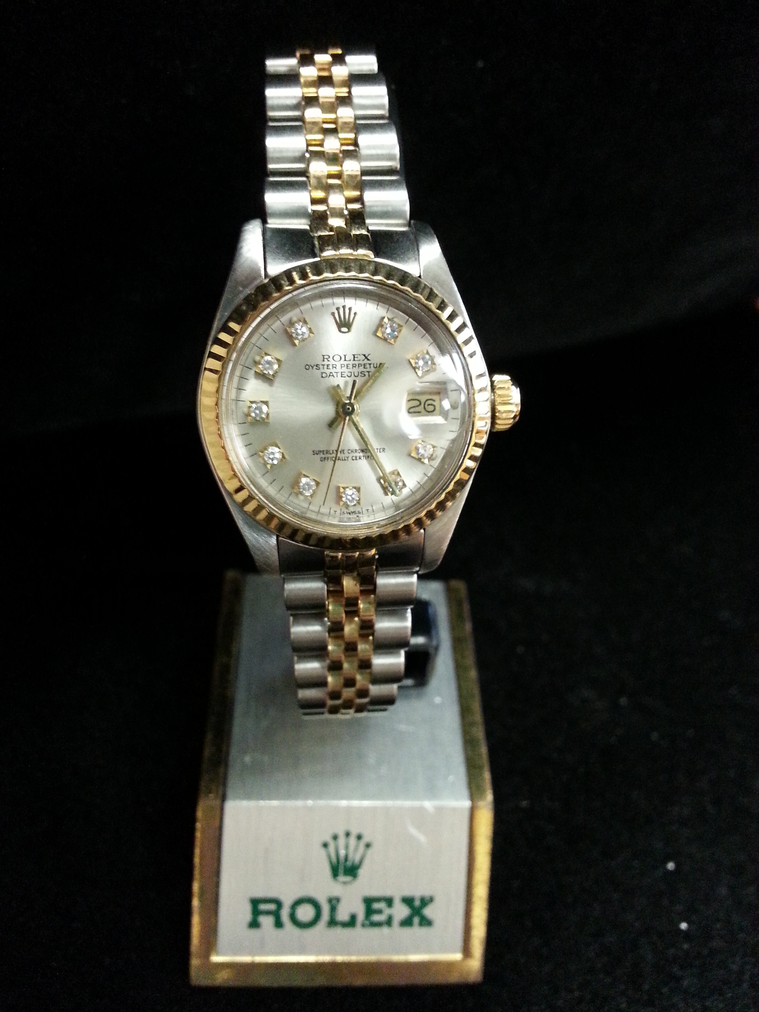 Estate two tone Lady's Rolex: Estate Lady's Stainless Steel and 18k Yellow Gold Rolex Datejust with Diamond Dial.